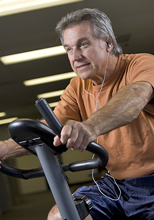Man using exercise bike.